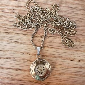 Gold tone clock necklace